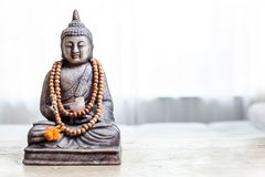 Buddha statue in white room. stock photos