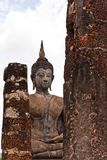 Buddha statue behind  pillars Stock Photos