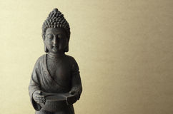 Buddha statue on a beige background Royalty Free Stock Photo
