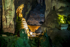 Buddha statue with Big snake statue in the cave Royalty Free Stock Images