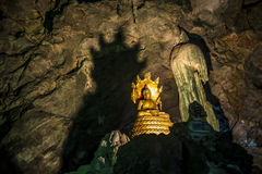 Buddha statue with Big snake statue in the cave2 Stock Image