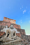 Buddha statue in blue sky Stock Photos