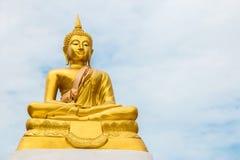 Buddha statue on blue sky as background Stock Photo
