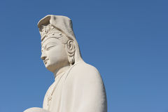 Buddha statue, blue-sky background Royalty Free Stock Images