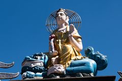 Buddha statue and blue sky background