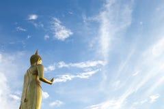 Buddha statue. On blue sky background Royalty Free Stock Photo
