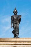 Buddha statue on blue sky background Stock Photography