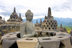 Buddha statue, Borobudur, Indonesia. Buddha statue missing its perforated stupa cover, Borobudur, Indonesia royalty free stock images