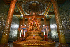 Buddha Statue in Botataung Pagoda at Yangon, Myanmar. Yangon, Myanmar - May 4, 2014: Buddha Statue in Botataung Pagoda. The pagoda is hollow within, and houses stock image