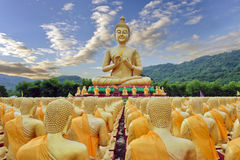 Buddha statue in Buddha park temple Nakohn Nayok, Thailand. Buddha statue with sky and mountain at Buddha Maka Bucha park temple Nakohn Nayok, Thailand Stock Image