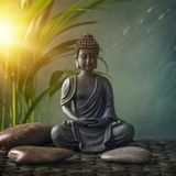 Buddha statue. On a blue background stock photos