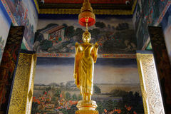 Buddha statue and Buddhist monk chanting in Wat Bovoranives, Bangkok, Thailand. Stock Photos