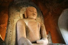 Buddha statue in Burma. A Buddha statue inside an ancient Shwezigon Pagoda: The many pagodas and stupas across the Bagan landscape were built between 849 and royalty free stock photo