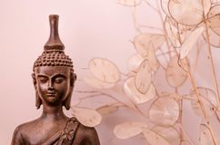 Meditating Buddha. Buddha statue can be used as a greeting card Royalty Free Stock Photography