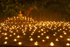 Buddha statue and candle in Chiangmai Thailand Stock Photos
