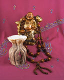 Buddha statue, candle holder for fragrant oils, beads made of wo Stock Images