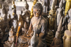 Buddha statue with candle. In lao cave Stock Photography