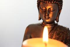 Buddha Statue and Candlelight Stock Image