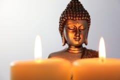 Buddha Statue and Candlelight Stock Photos