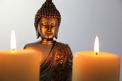 Buddha Statue and Candlelight Stock Images