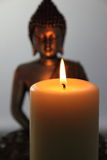 Buddha Statue and Candlelight Royalty Free Stock Image