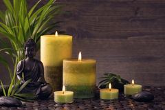 Buddha statue and  candles. On a brown background royalty free stock photo