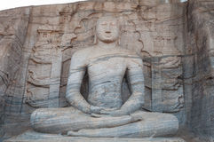 Ancient Buddha statue in Gal Vihara, ancient city of Polonnaruwa, Sri Lanka. Unesco World Heritage Site. Royalty Free Stock Photo