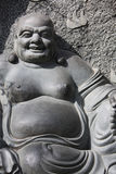 Buddha Statue. Carved in stone. Happy looking Royalty Free Stock Photo