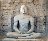 Buddha statue carved in to the rock Stock Photos