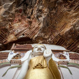 Buddha statue with carvings in Kaw Goon cave in. Buddha statue with carvings in Kaw Goon cave in Myanmar Royalty Free Stock Image