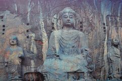 Buddha statue in the center of Longmen Grottoes. The Longmen Grottoes are located on the Longmen Mountain and Xiangshan Cliffs in the southern suburbs of Luoyang stock photo