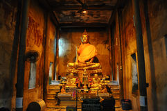 Buddha statue in chapel Stock Image