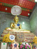 Buddha statue in the church. Golden Buddha statue located in the church North of Thailand Royalty Free Stock Photo