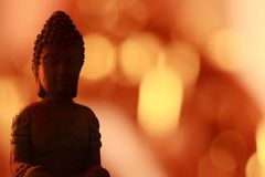 Buddha Statue close-up with bokeh lights background stock image