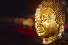 Buddha statue. Closeup of the antique buddha bronze statue with gold foil Stock Images