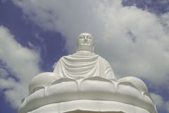 Buddha statue in the cloudy sky Royalty Free Stock Photos