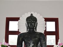 Buddha statue. Buddha created a black The architecture of the human Stock Photos