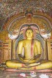 Buddha Statue at Dambulla Rock Temple, Sri Lanka. Image of a Buddha statue in a cave at the ancient Rock Temple, Dambulla, Sri Lanka. This is a UNESCO World Stock Image