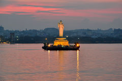 Buddha Statue. At dusk in Hussain Sagar Lake in Hyderabad, India Royalty Free Stock Image