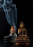 Buddha statue, essential oil and stones zen Stock Photography