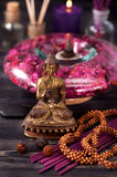 Buddha statue, essential oils, incense sticks. Spa and aromatherapy concept. royalty free stock photos