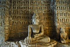 Buddha statue with figurines Royalty Free Stock Photos