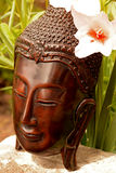 Buddha statue with a flower background Stock Photography