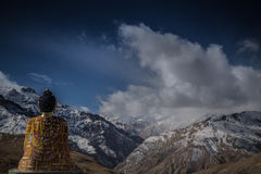 Buddha Statue in Front of Cloud Covered Mountains Royalty Free Stock Image