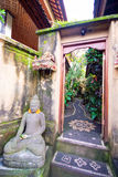Buddha statue in front of a home Stock Image