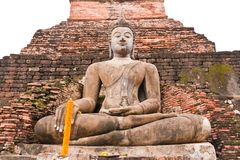 Buddha statue in front of pagoda Stock Image