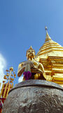Buddha statue in front of stupa Royalty Free Stock Images