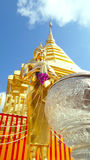 Buddha statue in front of stupa Royalty Free Stock Photography