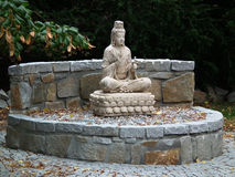 Buddha statue in garden Stock Images
