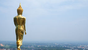 Buddha statue - Golden Buddha on the hill. Background sky Royalty Free Stock Image